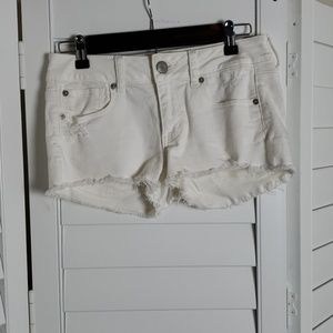 American Eagle white distressed denim shorts